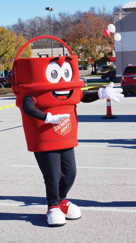 Captain Kettle dances Friday during the kickoff of the Salvation Army's Red Kettle Campaign. (Photo by Michael Erb)