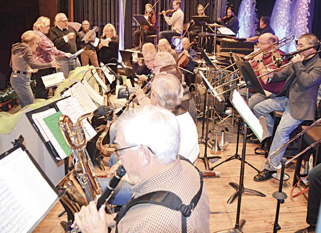 Photo by Brett Dunlap The Smoot House Band, the Smoot Singers and others rehearse Sunday for the annual Hometown Christmas show which will be performed Friday at the Smoot Theater in Parkersburg.