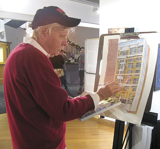 Photo by Jeffrey Saulton Michael Penn puts the finishing touches on a drawing of the Highmark Building. He was one of the artisans selling items at the Parkersburg Art Center on Saturday.