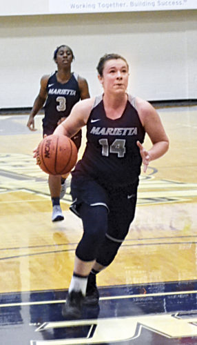 Photos by Ron Johnston Marietta College's Brooke Borich goes in for a layup during Turkey Shoot Tournament action at the BanJo Sunday afternoon. Borich was named the tourney MVP after the Pioneers beat Wittenberg, 88-76.