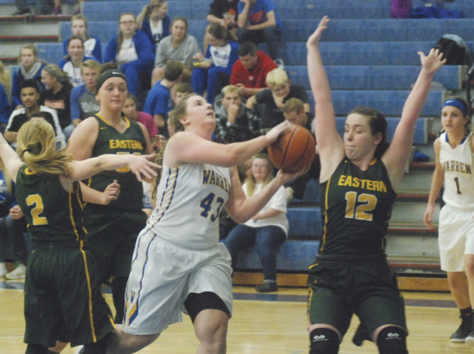 Warren's Emily Jackson (43) drives the lane as Eastern's Jessica Parker (2), Maddison Williams (12) and Elizabeth Collins defend during a high school girls basketball game Thursday in Vincent. Warren won, 61-42. Photo by Jordan Holland.