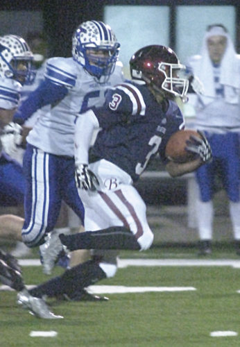 Bluefield's Mookie Collier breaks out for a big run against Fairmont Senior's defense during the Class AA state title game Friday night inside Wheeling Island Stadium. Collier and the Beavers won a 29-26 thriller over the Polar Bears. Photo by Joe Albright.