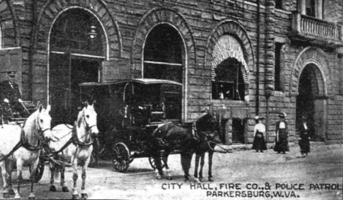 "Photo Provided Shown above is a portion of the old Parkersburg City Building that faced Fifth Street.  This portion housed the Fire Department and Police Patrol.  The city ""lock-up,"" or jail, was below street level. This building was not completed until 1896."
