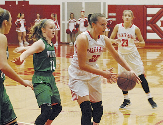Parkersburg's Madi Mace (35) makes a move with the ball as Waterford's Rachael Adams (14) defends during a high school girls basketball game Saturday night at Parkersburg Memorial Fieldhouse. Photo by Jordan Holland.