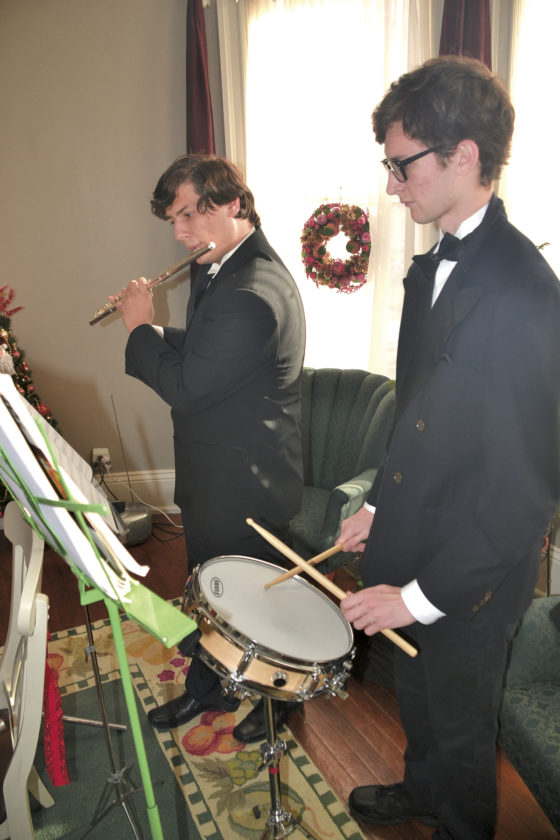 Photo by Brett Dunlap Gage Anthill and Hayden Thatcher played music in one of the homes on the Julia-Ann Square Historic District's Victorian Christmas Home Tour held over the past weekend.