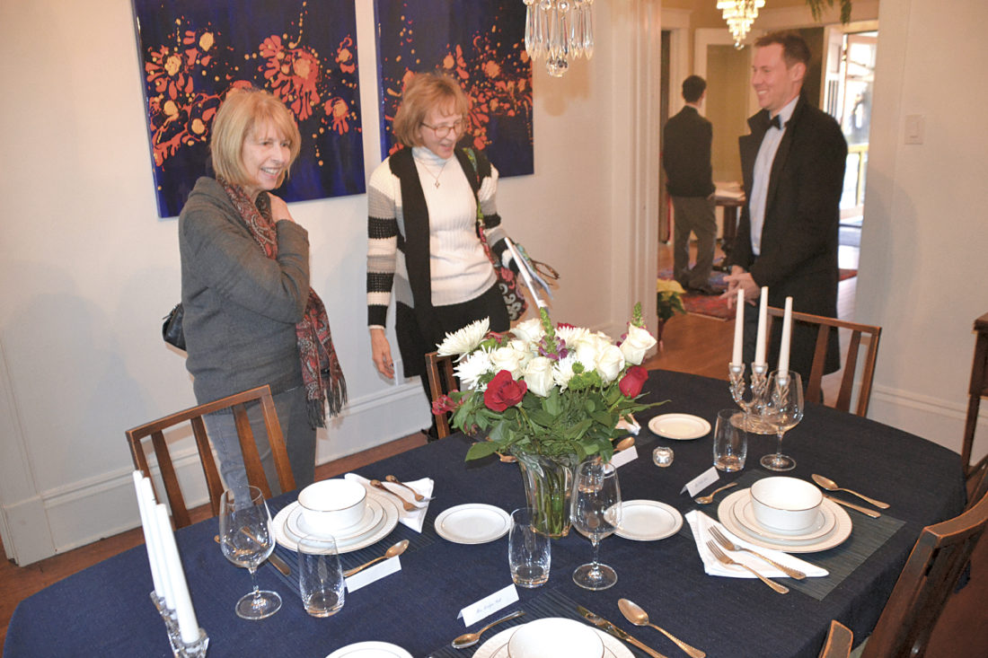 Photo by Brett Dunlap Judy Johnson, of Vincent, and Diane McMichael, of Barlow, talk with Justin Roedersheimer about the decor in his home during the Julia-Ann Square Historic District's Victorian Christmas Home Tour held over the past weekend.