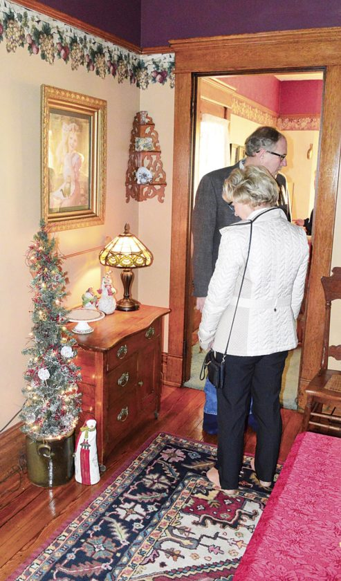 Photo by Doug Loyer Visitors admire the Christmas decorations in the Skinner house on the tour.
