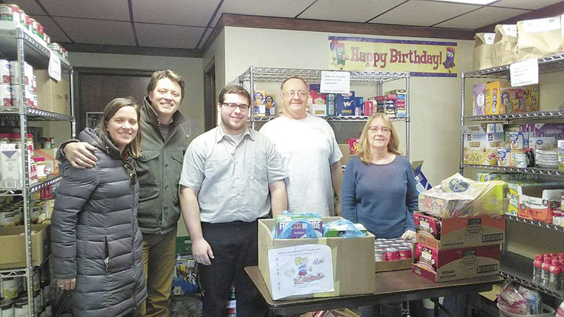 Photo Provided McClinton Chevrolet-Mitsubishi employees Ginny McClinton Bowden, Wyn Bowden, Isaiah Defrietas and Dan Talbott delivered food to Lisa Weaver, program coordinator of the Mid-Town Family Resource Center.