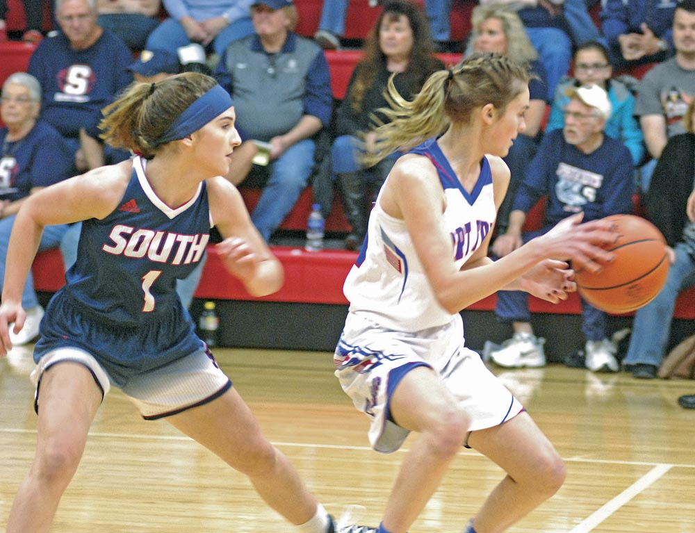South's Kenzie Johnson tails Fort Frye's Morgan Borich during a high school basketball game Monday night.