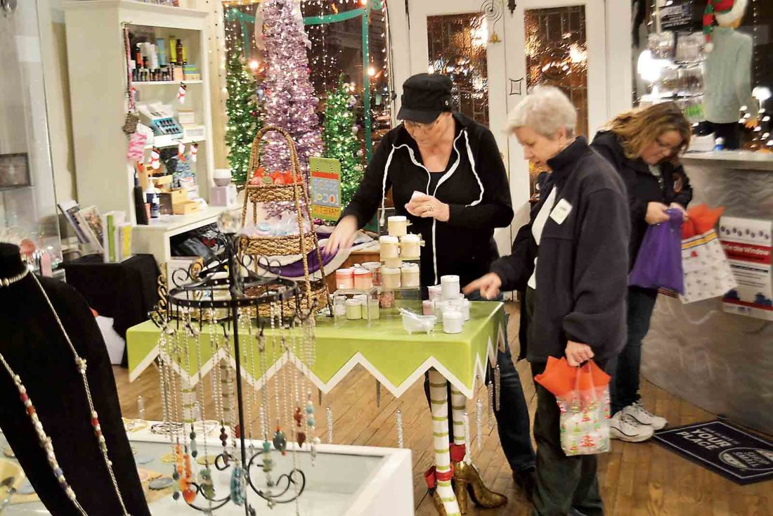 A customer looks at a potential gift during the Monday night Cash Mob tour of Twisted Sisters boutique on Front Street. (Photo by Michael Kelly)