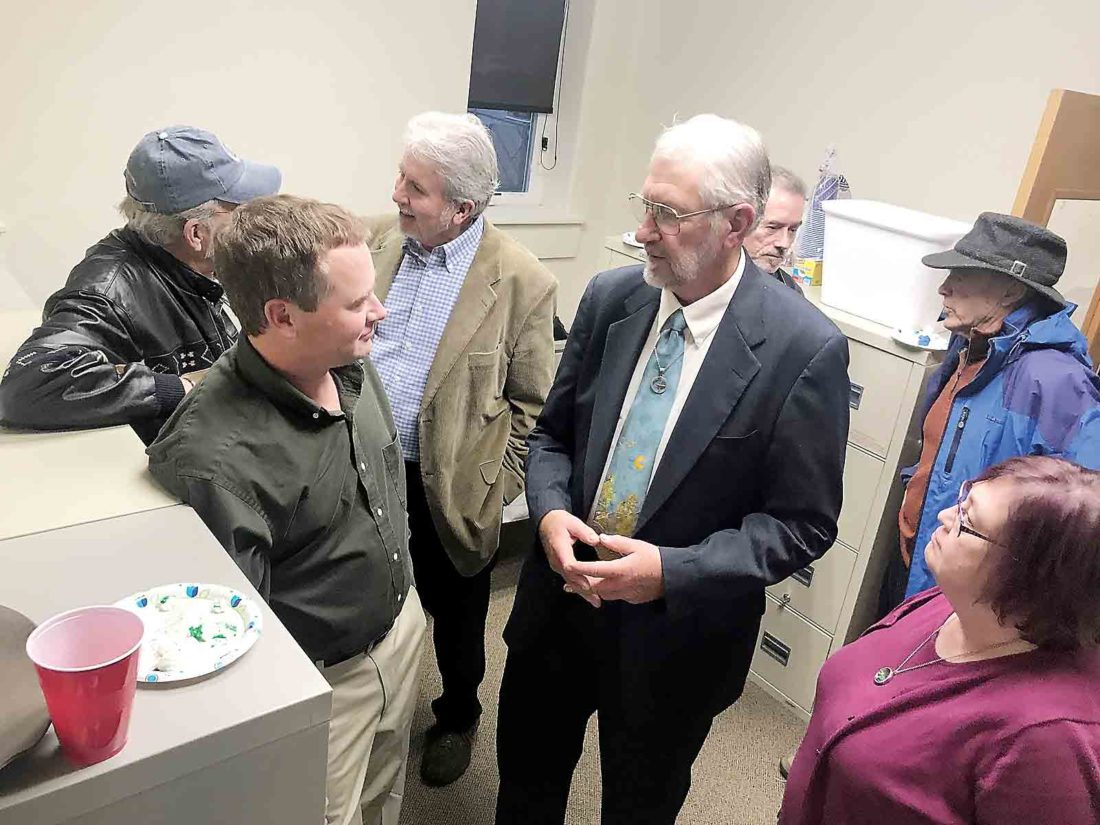 Tom Vukovic and Roger Kalter, center, talk with colleagues on Marietta City Council Tuesday in Marietta during a  reception for their retirement. (Photo by Janelle Patterson)