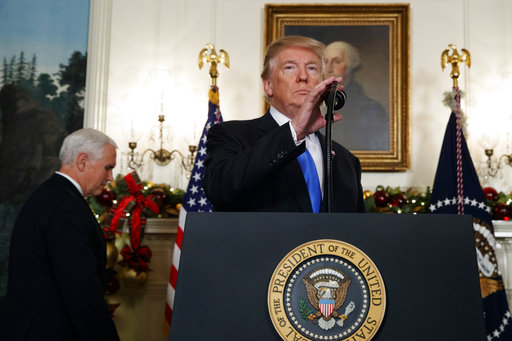 President Donald Trump arrives to deliver a statement to officially recognize Jerusalem as the capital of Israel, in the Diplomatic Reception Room of the White House, Wednesday, Dec. 6, 2017, in Washington. (AP Photo/Evan Vucci)