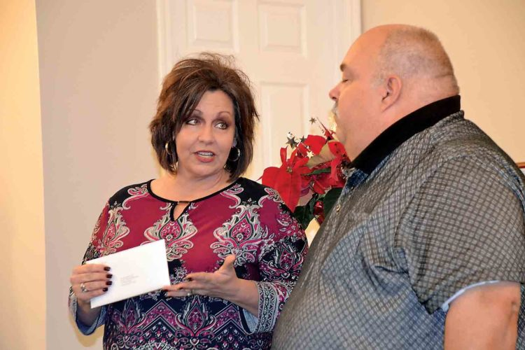 Photo by Brett Dunlap Christina Smith and Doug Hess of the Arc of the Mid-Ohio Valley accepted a $5,012 grant award Wednesday from the Parkersburg Area Community Foundation & Regional Affiliates' Fall Grant Awards.