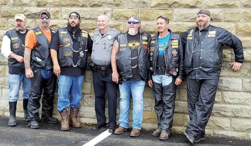 Photo provided by Donnie Washburn Members of the Tramps Motorcycle Club pose with Marietta Police officer AJ Linscott during a past toy run to raise money for children in the foster care program.