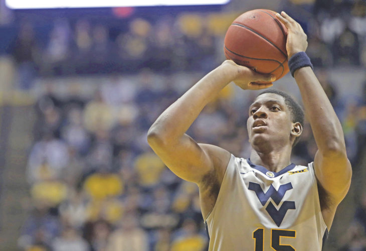 West Virginia forward Lamont West shoots a free throw during the second half of an NCAA college basketball game Tuesday against Virginia in Morgantown. West Virginia defeated Virginia 68-61.