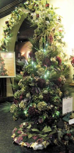 "Receiving the highest bid of $4,250 at the Festival of Trees was ""Where Flowers Bloom, So Does the Spirit of Christmas,"" which tied for first place in the most original category. (Photo by Jeffrey Saulton)"