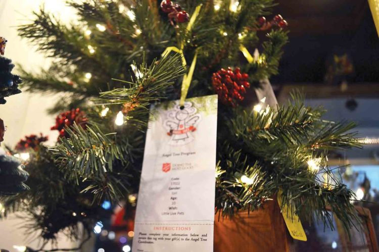 Photo by Michael Kelly Tags sit unclaimed on a Salvation Army Angel Tree in Green Acres on Front Street. The Salvation Army has about 60 more children in the program than it had last year.