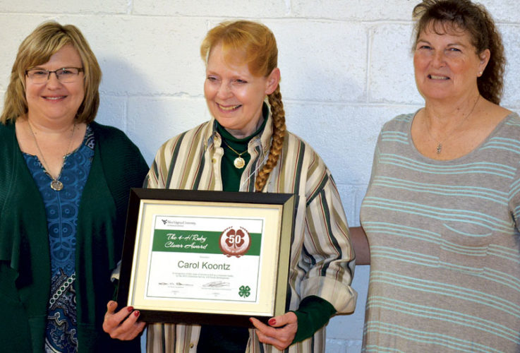 Photo Provided Jodi Smith, 4-H Extension Agent with Carol Koontz, 50 Year Volunteer, and Debbie Young, President of the Wood County 4-H Leaders' Association.