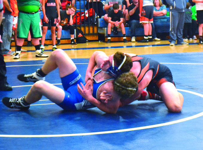 Photo by Mike Morrison Warren's Cole Hupp wrestles with New Lexington's Jacob Vance Saturday in the Hickory Grove Invitational at Warren High School. Vance won by decision in the 145-pound weight class.