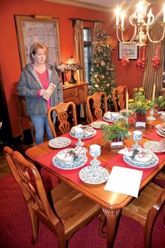 Marta Bailey and Mindy Smith tour the home of Tara and Troy Nelson on Sunday during the 50th annual Holly Trail Tour of Homes in Parkersburg. This year's tour included eight homes in Parkersburg and Vienna. (Photo by Brett Dunlap)