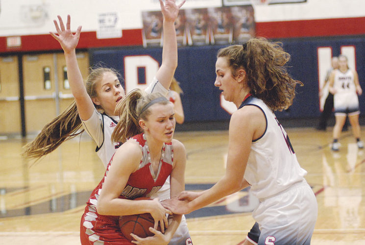 Parkersburg South's Makenna Winans and Devin Hefner pressure River's Mikenzie Cieszeski in the backcourt Monday in the Patriots' 57-41 win over the Pilots. Winans and Hefner also proved a force on the offensive end with 11 and 23 points respecitvely. Winans recorded a double-double with 12 boards. Photo by Joe Albright.