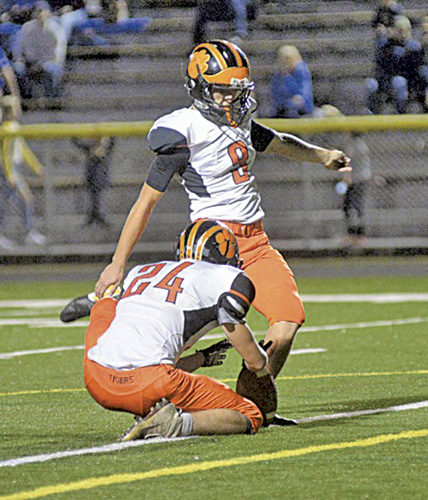 Elkins kicker George Triplett lines up a kick during a high school football game earlier this season