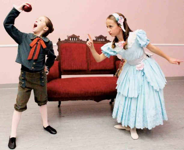 "Photo Provided Young Clara (danced by Anna Martin) scolds brother Fritz (danced by Josie Augenstein) for stealing an apple in Schrader Youth Ballet's upcoming production of ""The Nutcracker (Clara's Dream)."""