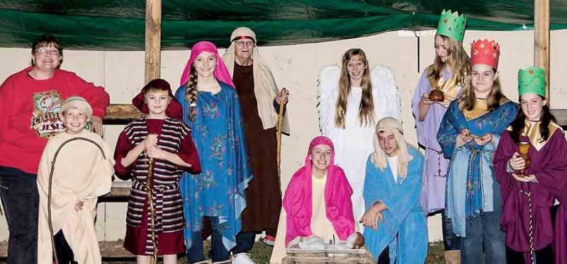 Photo submitted by Amy Peckens Those involved in a previous live nativity at Tunnel United Methodist Church pose for a picture. This year's nativity will be open from 6 to 7:30 p.m. Saturday.