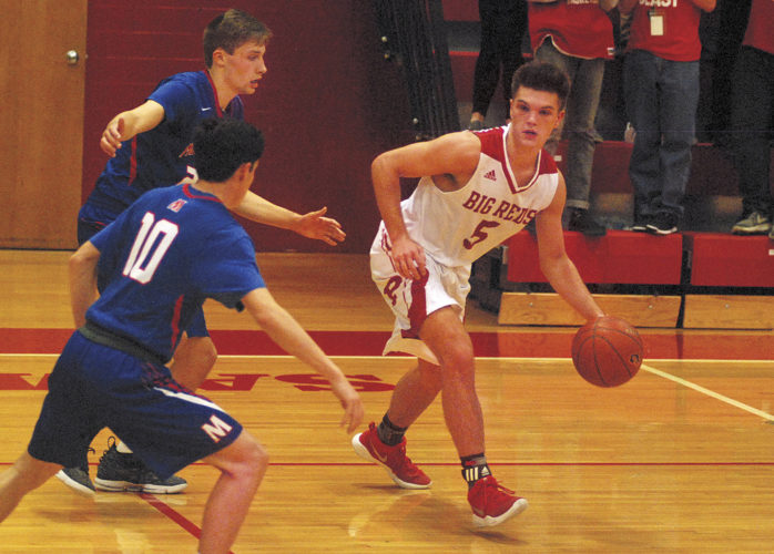 Photos by Jay W. Bennett Parkersburg's Parker Miller tries to avoid a trap by Morgantown's Andrew Selders (10) and Garrett Haines during the Big Reds' 60-56 victory Wednesday night against the Mohigans inside Memorial Fieldhouse.