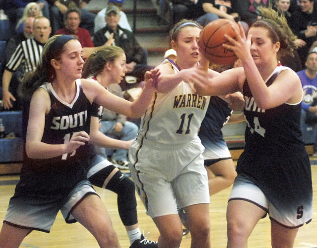 Photo by Jordan Holland Parkersburg South's Sierra Hays (left), Warren's Peyton Bowe (center) and Parkersburg South's Allie Taylor fight to collect a first-half rebound during the Patriots' 48-42 comeback win over the Warriors.