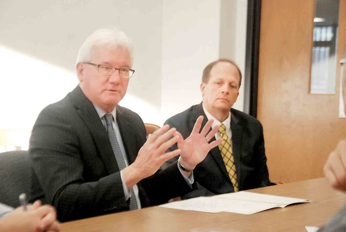 Photo by Evan Bevins WesBanco Market President Joe Campbell, left, speaks during a meeting of Parkersburg's Central Downtown Business District Design & Facade Committee Wednesday morning at the Municipal Building as WesBanco downtown branch manager Joe Marra listens.