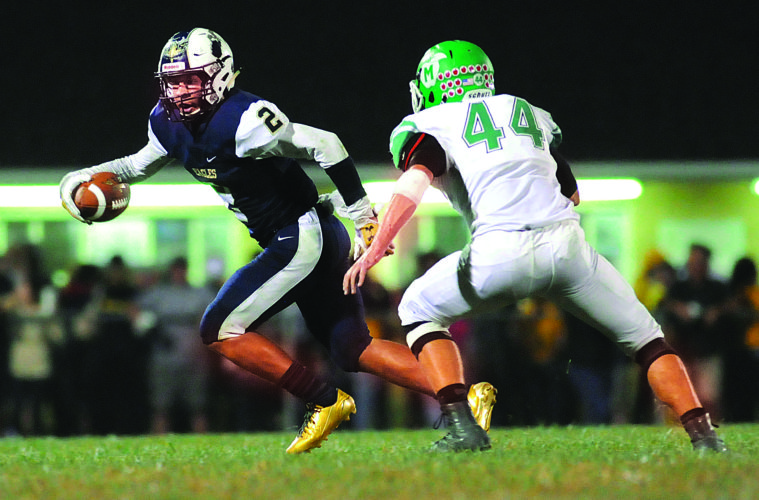 07 Muss@Hed FB4 ra 10-06-17 Hedgesville's Malakai Brown (2) runs with the ball as Musselman defender Jacob Northcraft (44)  pursues during the 1st quarter Friday night at Hedgesville. See more photos on CU.journal-news.net. (Journal Photo by Ron Agnir)