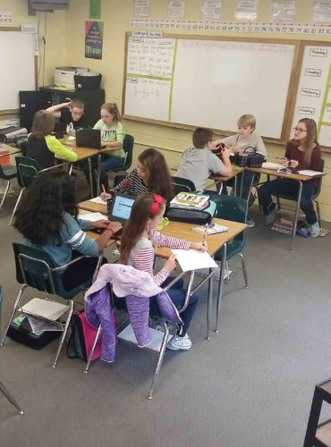 Photo Provided Sixth-grade math students under teacher Ashley Boggs at Jackson Middle School in Vienna are participating in the Stock Market Game. The students use an imaginary $100,000 to play the stock market.