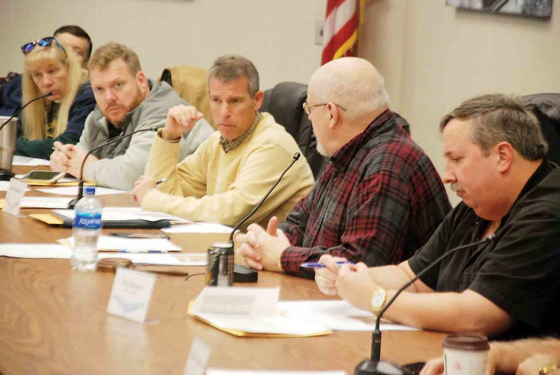 Photo by Evan Bevins Parkersburg Municipal Planning Commission member Sean Andrews, center, asks a question during Friday's commission meeting in council chambers. Also pictured are, from left, planning commission members Sherry Dugan, Eddie Staats, Charlie Matthews and Eric Gumm.