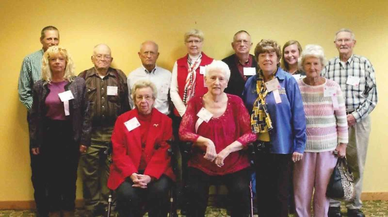 Photo Provided Members of the Wood County Farm Bureau attending the state Farm Bureau meeting were, from left, back row, Bruce McGlothlin, Ralph Blair, David Lawson, Kam Lawson, Roger Wigal, Teighlor Cross and Mark Young. Front row, Becky Powell, JoEllen Blair, Norma Cross, Janet Wigal and Shelia Young. (Photo Provided)