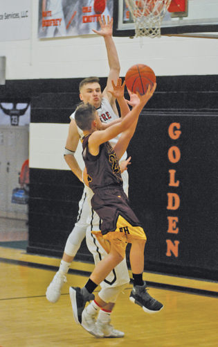 Belpre's Nate Godfrey (23) guards Federal Hocking's Collin Jarvis (22) with the ball Friday night in a 56-48 Golden Eagles' win over the visiting Lancers. Photo by Steve Hemmelgarn.