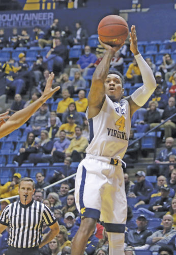 West Virginia guard Daxter Miles Jr. (4) shoots during the first half against Coppin State in an NCAA college basketball game Wednesday in Morgantown. West Virginia won 77-38.