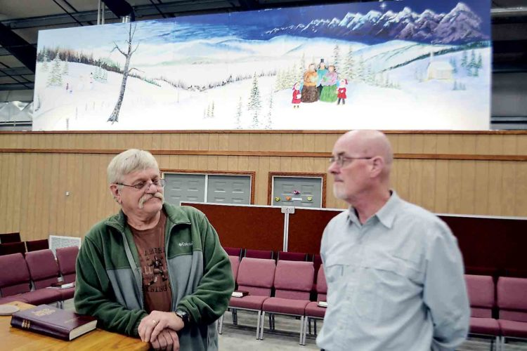Photo by Michael Kelly Artist Roger Bonnette and Pastor Karl Kesselring talk in the sanctuary of the Waterford Church of the Nazarene below the mural Bonnette painted for the church.