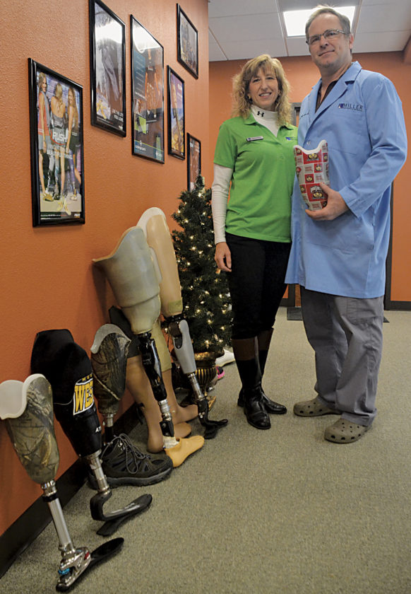 Photo by Brett Dunlap Nancy and Mark Miller, the owners of Miller Prosthetics and Orthotics, in their new Belpre facility. The company makes a variety of prosthetic limbs for amputees and people born without certain limbs.