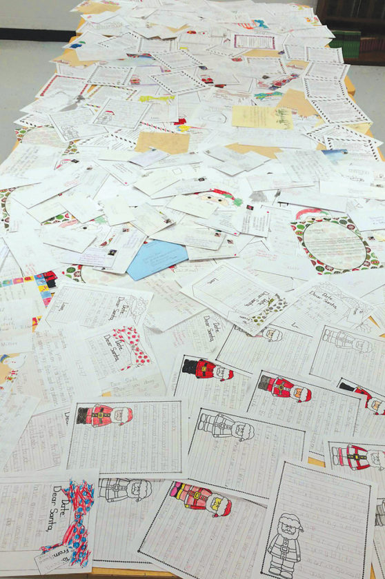 Photo Provided More than 300 area children sent letters for Santa Claus to Parkersburg South High School, and students made sure every one got a personal ...