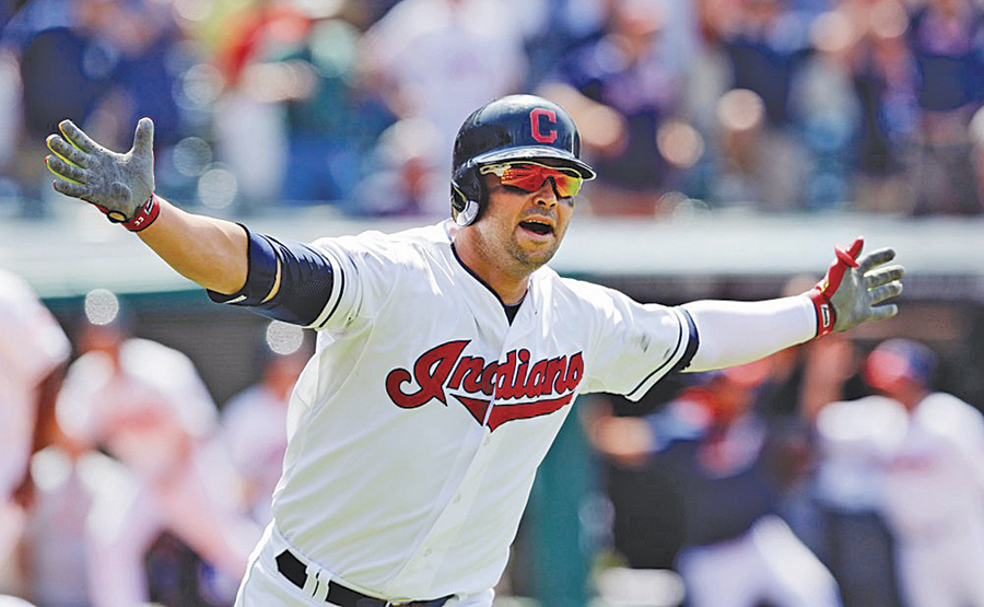 Parkersburg High graduate Nick Swisher celebrates after hitting a grand slam during a 2014 Major League Baseball game in Cleveland. Swisher is one of three 2018 inductees into the Parkersburg High School Sports Hall of Fame.