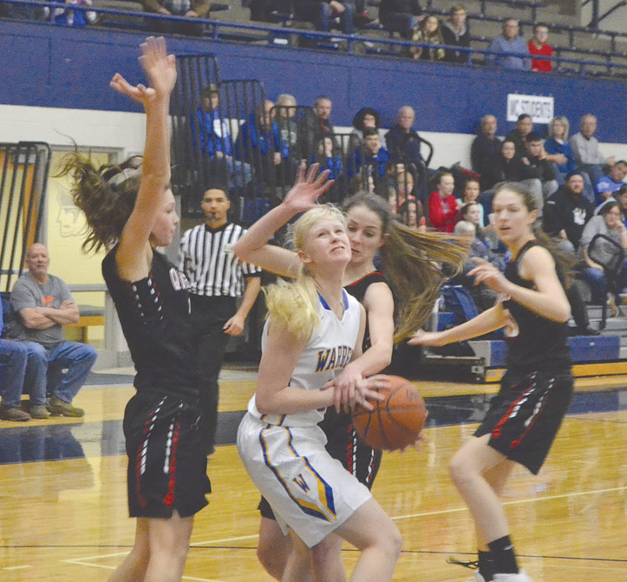 Warren's Olivia Alloway makes a move with the ball during a River City Classic girls basketball game against New Philadelpia Saturday at Ban Johnson Arena. Photo by Mike Morrison.