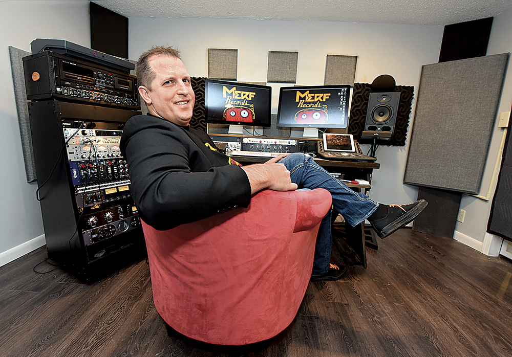 Photo by Jeff Baughan Merf Records owner and recording artist Steve Hussey and the main control area in the Merf Records Studio. Hussey said the days of the massive sound boards for recording sessions are disappearing due to the available technology.