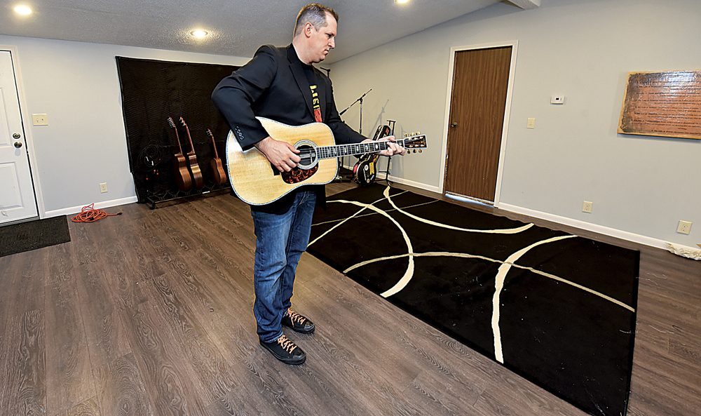 Photo by Jeff Baughan Merf Records owner and recording artist Steve Hussey plays his guitar in the area which bands, groups or solo musicians with backup musicians can record in.