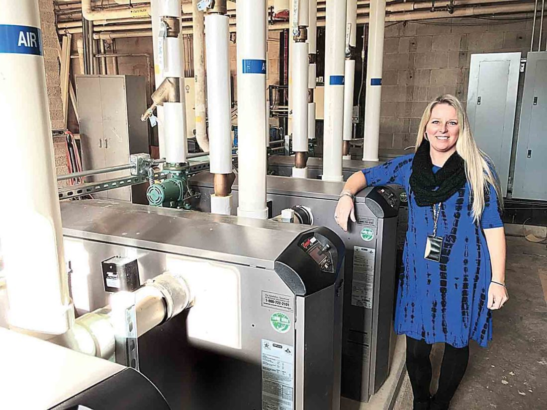 In this photo from Dec. 8, 2016, Hamilton Middle School Assistant Principal Kelley Ray stands with newly installed Lochinvar heating units. Hamilton Middle was closed Tuesday due to heating issues amid bitterly cold temperatures. (File Photo)