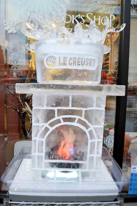 Photo by Michael Kelly A stove carved of ice offers at least the idea of warmth outside The Cook's Shop on Front Street on First Fridays in downtown Marietta. January's theme was Fire & Ice, and dozens of people braved frigid temperatures to walk the downtown streets, view the ice sculptures, shop and eat Friday night.