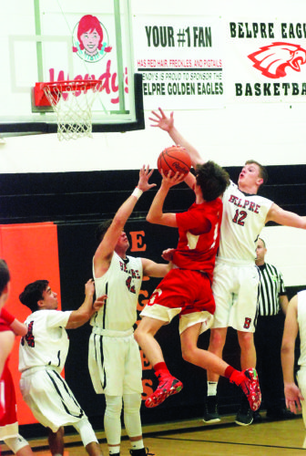 Belpre's Brandon Simoniette (12) and Bailey Sprague (42) challenge South Gallia's Braxton Hardy at the rim during a high school boys basketball game Friday.  Photo by Steve Hemmelgarn