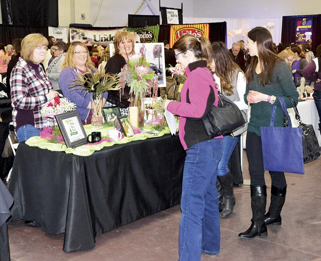 Photo by Doug Loyer Two Peas in a Pod displayed some of its floral designs Sunday at the bridal show.