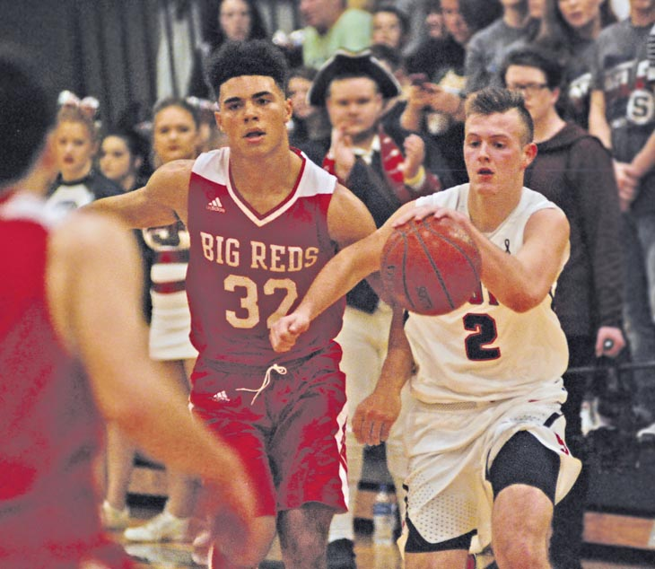 Parkersburg's Brenton Strange (32)pursues Parkersburg South's Seth Fallon as he brings the ball up the floor during the Patriots' 51-46 win over PHS back on Dec. 22. Photo by Joe Albright.