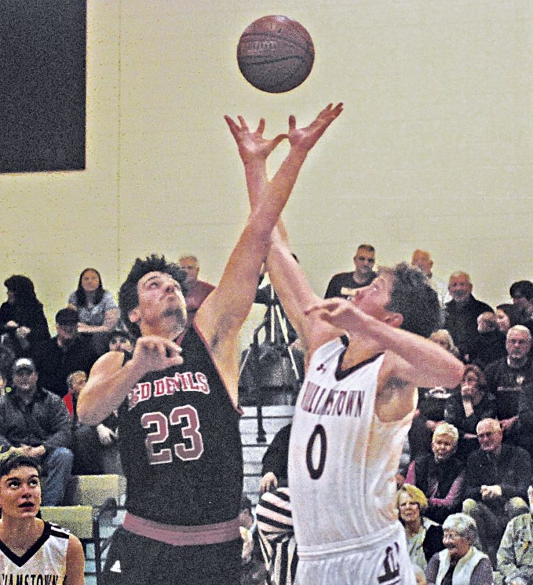 Ravenswood's Stephen Dawson, who had the game-winning bucket late in the fourth quarter during the Red Devils' 62-61 road victory Tuesday night, wins the jump ball to open the game against Williamstown's Cullen Cutright. Photo by Jay W. Bennett.
